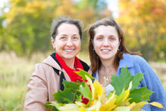 Women in autumn  park Royalty Free Stock Photo