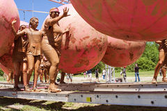 Women Avoid Obstacles At Dirty Girl Mud Run. Hampton, GA, USA - April 23, 2016: Women try to keep their balance as they dodge large rubber balls at one of the royalty free stock photography