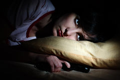Women awoke with the gun under the pillow Stock Photo