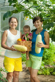 Women and baby  with  harvested vegetables Royalty Free Stock Image