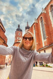 Women on background of Church St. Mary in the main Market Square. Krakow. Stock Photo