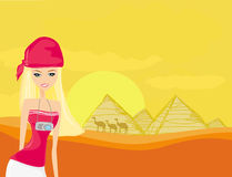 Women on background the pyramids in Giza Stock Images