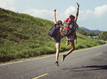 Women Backpacker Jumping on The Street Stock Photos