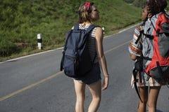 Women Backpacker Walking along The Street Side Stock Image