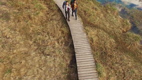 Women Backpackers Walking Down the Path. Aerial: Two Women Backpackers Walking Down The Path At Summer stock footage