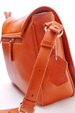 Women bag. Orange women satchel on a white background Stock Photo