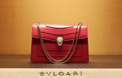 Women bag bulgari. Bulgari (Italian pronunciation: [ˈbulɡari]) is an Italian jewelry and luxury goods company. The trademark is usually written BVLGARI in the Stock Photos