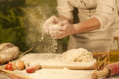 Women baker hands mixing,recipe kneading preparation dough and making bread Stock Photo