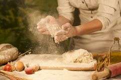Women baker hands mixing,recipe kneading butter, tomato preparation dough and making bread Royalty Free Stock Photography