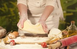 Women baker hands recipe flour pasta butter tomato preparation dough and making bread Stock Image