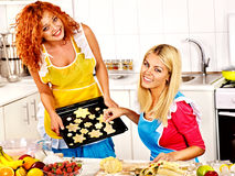 Women baking cookies in the oven Stock Images
