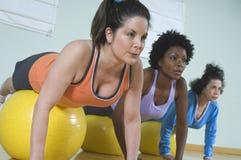 Women Balancing On Fitness Ball Stock Image