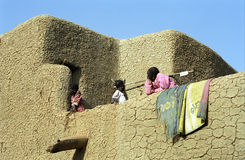 Women in the balcony, Djenne, Mali Stock Photos
