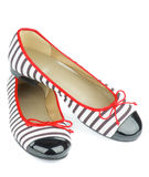 Women Ballet Flats. Contemporary Striped and Varnished Women Ballet Flats isolated on white background stock photo