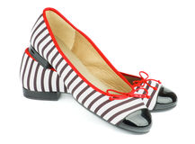 Women Ballet Flats. Elegant Striped and Varnished Women Ballet Flats isolated on white background stock photo