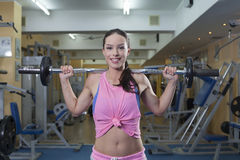 Women with barbells Royalty Free Stock Image