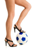 Women bare legs with soccer ball Stock Photos