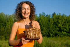 Women with basket on glade Royalty Free Stock Image