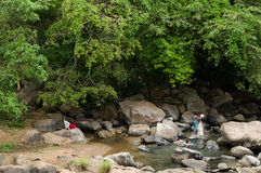 Women Bathing in a Tropical Creek Stock Image