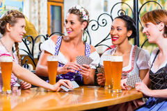 Women in Bavarian pub playing cards. And a game of Schafkopf royalty free stock photography