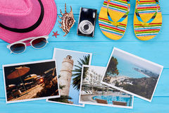 Women beach accessories above photos. Stuff for sea, photos of resorts, blue background. Choose the place of vacation Royalty Free Stock Image