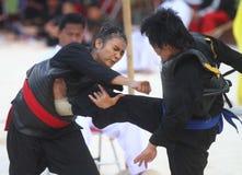 Women Beach martial art Stock Images