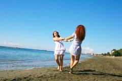 Women on beach stock photography