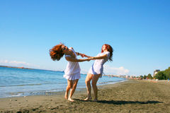 Women on beach royalty free stock images