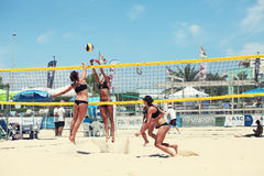 Women beach volleyball players. Attack and defense Stock Photography