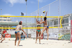 Women beach volleyball players. Attack and defense Royalty Free Stock Images