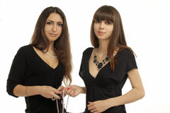 Women and beads Royalty Free Stock Image