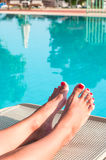 Women beautiful feet with painted red nails Royalty Free Stock Photography