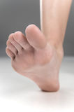 Women beautiful Foot stepping closeup. Stock Photography