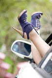 Women beautiful legs shoes, car window Stock Photo