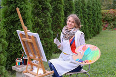 Women beautiful painter posing and smiling, laughing into camera Royalty Free Stock Image