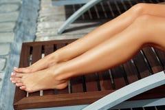 Women beautiful legs on the beach. Women beautiful legs on the beach royalty free stock photos
