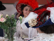 Women in beautiful vintage style hats with feather talk. RUSSIA, MOSCOW, TIME AND EPOCH FESTIVAL, 8 JUNE 2014 - Women in beautiful vintage style hats with Royalty Free Stock Photos
