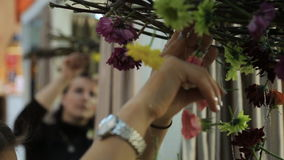Women beautify space of room in workshop with flowers stock footage