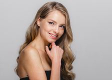 Women beauty face. Beautiful Blonde Woman Beauty Model Girl with. Perfect makeup and hairstyle. Studio shot royalty free stock photography