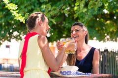 Women in beergarden having refreshment Stock Images