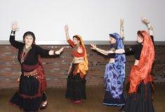 Women belly dancing stock photo