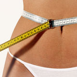Women belt funny concept. Woman belt funny concept - weight measure stock photography