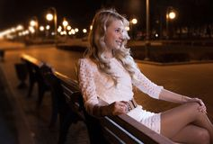Women on bench at night Royalty Free Stock Photo