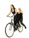 Women on a bicycle Stock Image