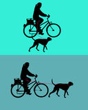 Women on bicycle with dog Stock Photos