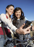Women With Bicycle Photographing Themselves Stock Photo
