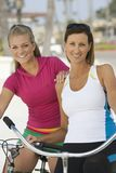 Women With Bicycles Stock Photo