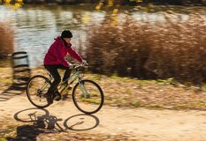 Women on the bike royalty free stock photography