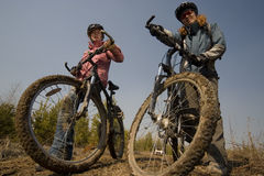 Women bikers. Two women-bikers standing. Shot from below Stock Photography