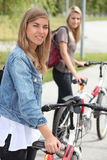 Women with bikes Stock Images